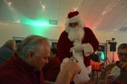 Santa is giving Grady a surprise